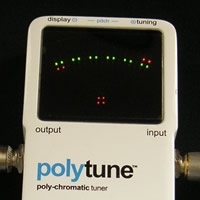 Polyphonic tuning mode, showing the low-E string flat (left) and the high-E string sharp (right). (Click for bigger image)