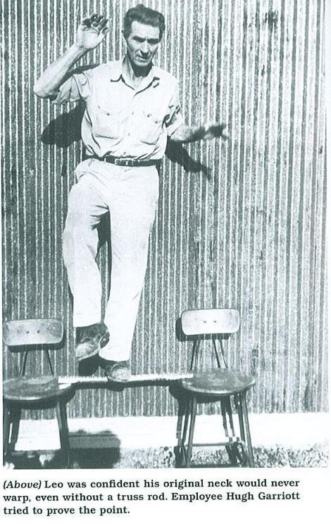 Man Standing on Fender Neck